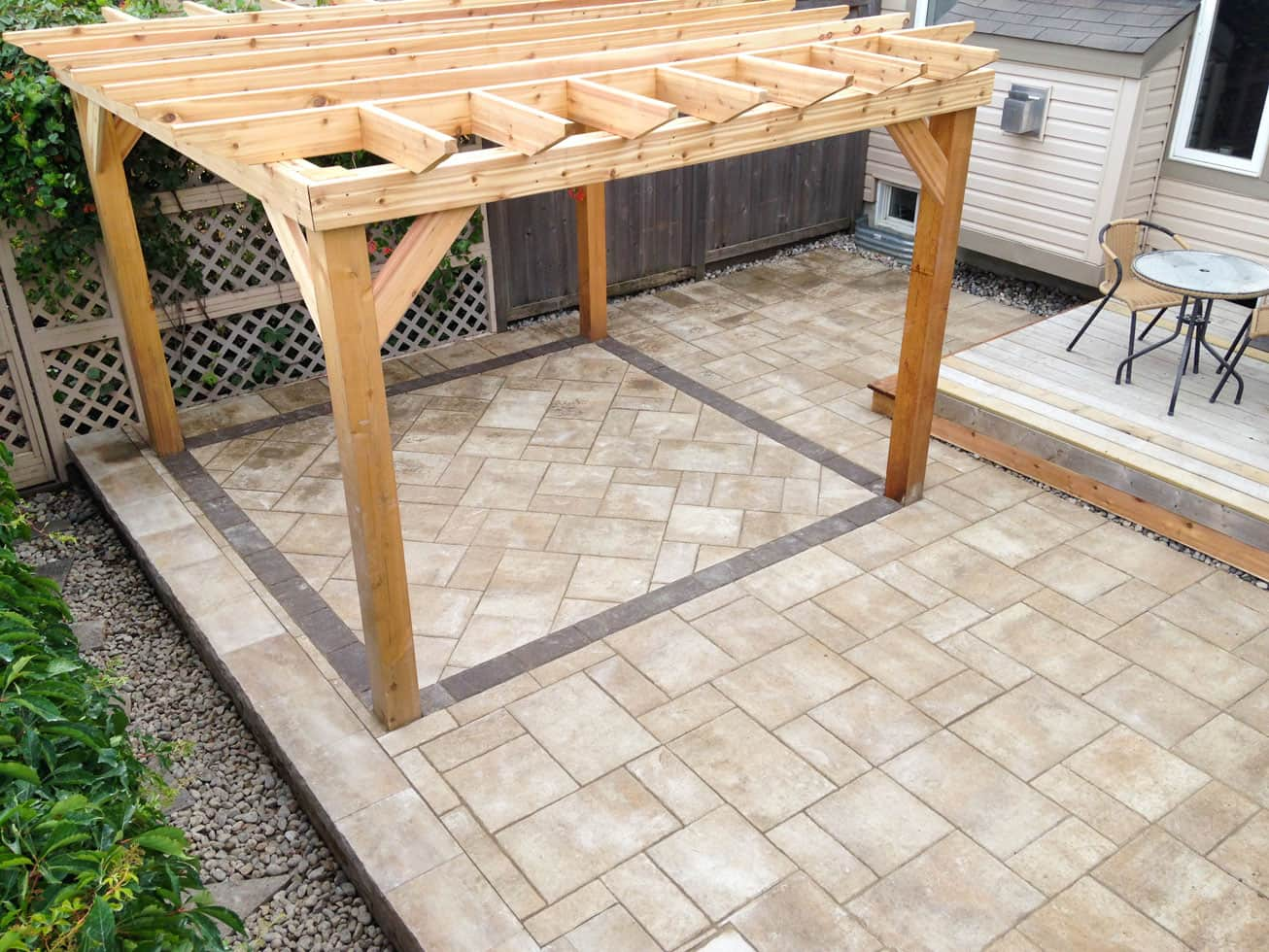 cedar pergola with interlock patio
