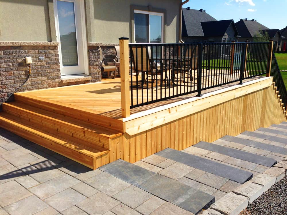 wooden deck with interlock pathway